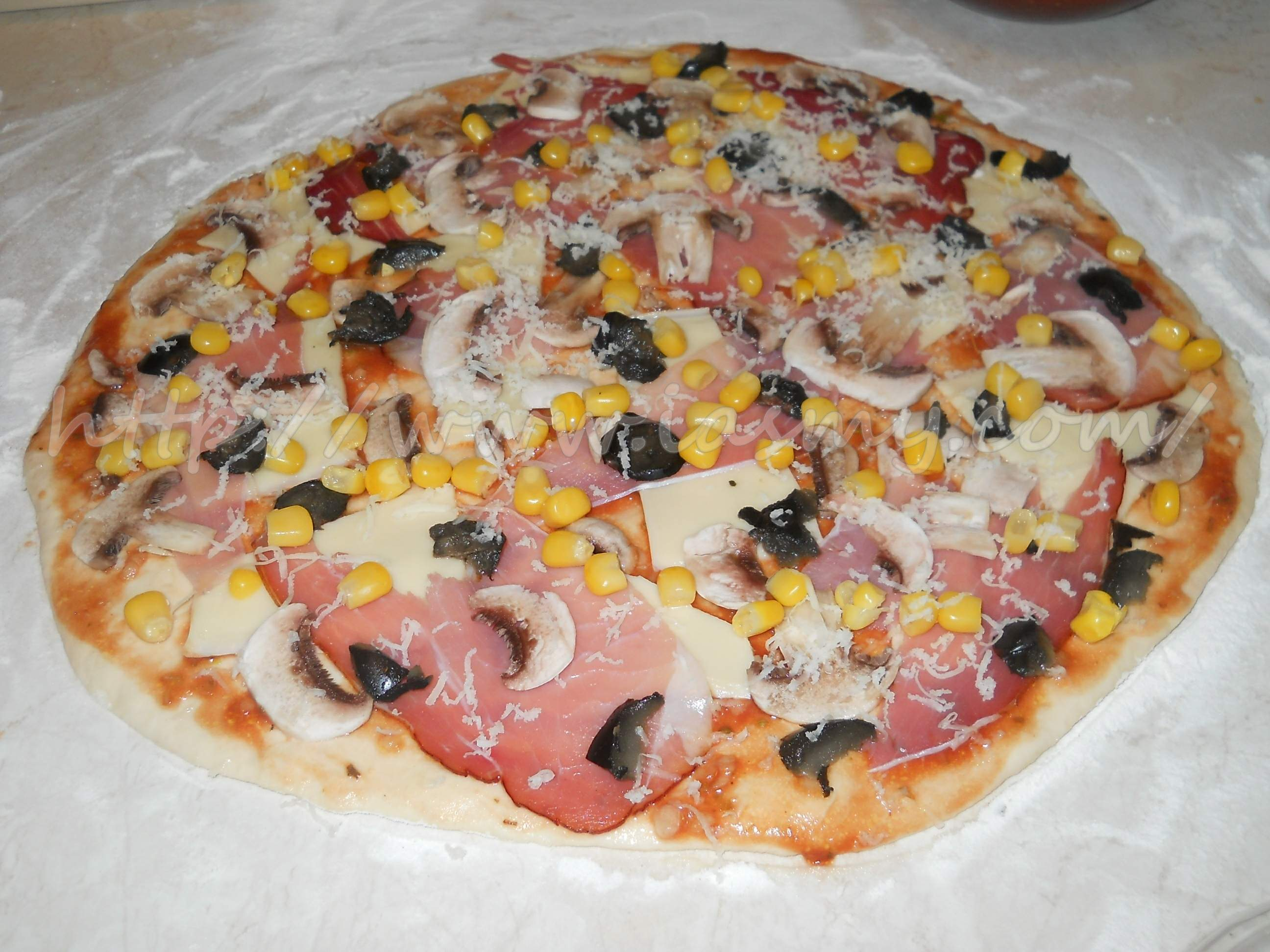 Pizza rapidă la maşina de făcut pâine